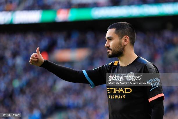 Ilkay Gundogan of Manchester City gives a thumbs up during the Carabao Cup Final between Aston Villa and Manchester City at Wembley Stadium on March...