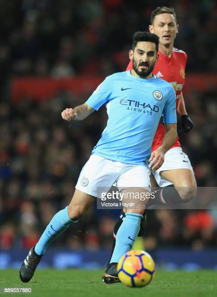 Ilkay Gundogan of Manchester City holds of Nemanja Matic of Manchester United during the Premier League match between Manchester United and...