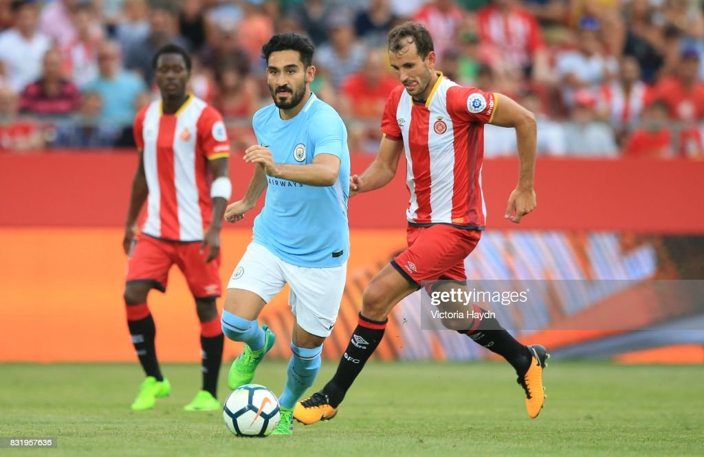 Ilkay Gundogan of Manchester City in action during the pre-season friendly match between Girona and Manchester City at Municipal de Montilivi Stadium on August 15, 2017 in Girona, Spain.