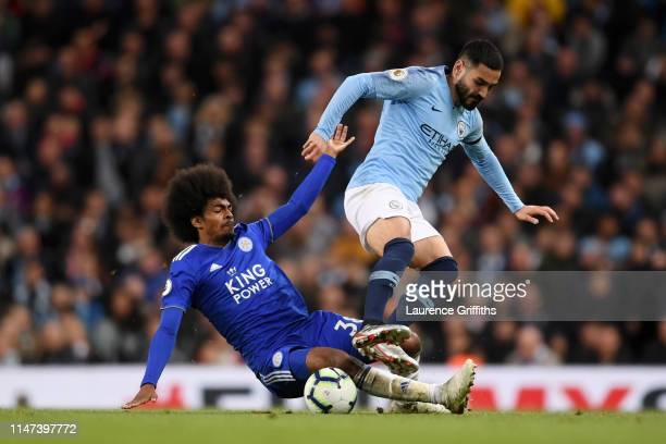 Ilkay Gundogan of Manchester City is challenged by Hamza Choudhury of Leicester City during the Premier League match between Manchester City and...