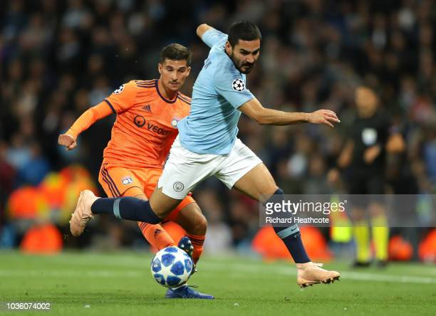 Ilkay Gundogan of Manchester City is challenged by Houssem Aouar of Lyon during the Group F match of the UEFA Champions League between Manchester...