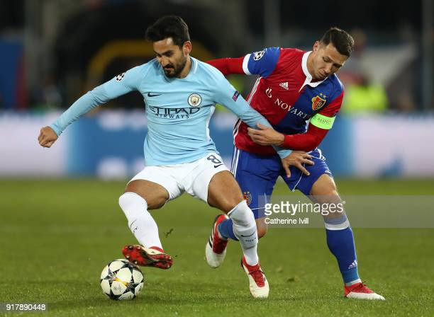Ilkay Gundogan of Manchester City is challenged by Marek Suchy of FC Basel during the UEFA Champions League Round of 16 First Leg match between FC...