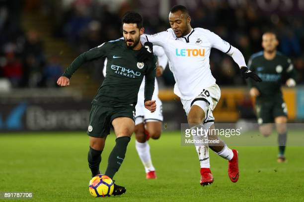 Ilkay Gundogan of Manchester City is challenged by Martin Olsson of Swansea City during the Premier League match between Swansea City and Manchester...