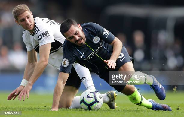 Ilkay Gundogan of Manchester City is challenged by Maxime Le Marchand of Fulham during the Premier League match between Fulham FC and Manchester City...