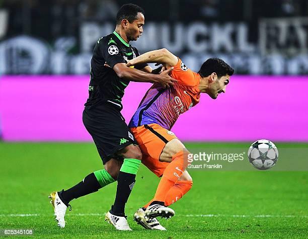 Ilkay Gundogan of Manchester City is challenged by Raffael of Borussia Moenchengladbach during the UEFA Champions League match between VfL Borussia...