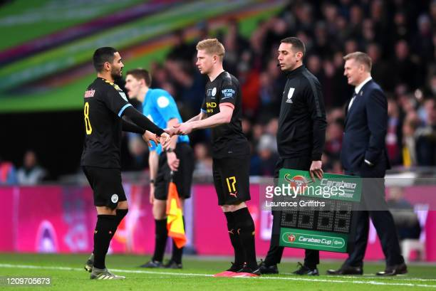 Ilkay Gundogan of Manchester City is replaced by Kevin De Bruyne during the Carabao Cup Final between Aston Villa and Manchester City at Wembley...