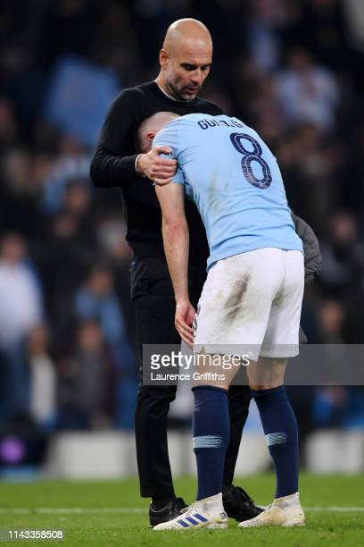 Ilkay Gundogan of Manchester City looks dejected as he is consulted by Josep Guardiola Manager of Manchester City after the UEFA Champions League...