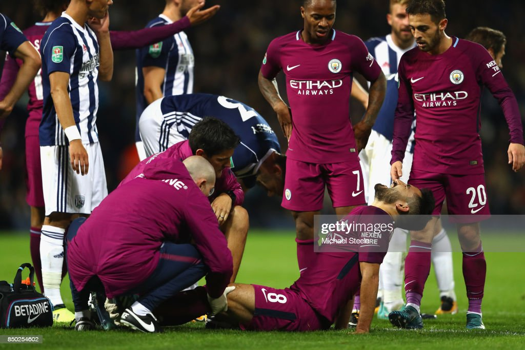Ilkay Gundogan of Manchester City receives treatment from the medical team during the Carabao Cup Third Round match between West Bromwich Albion and Manchester City at The Hawthorns September 20, 2017 in West Bromwich, England.