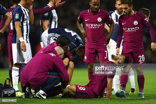 Ilkay Gundogan of Manchester City receives treatment from the medical team during the Carabao Cup Third Round match between West Bromwich Albion and...