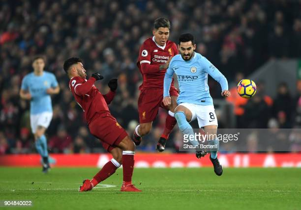 Ilkay Gundogan of Manchester City Roberto Firmino of Liverpool and Alex OxladeChamberlain of Liverpool in action during the Premier League match...