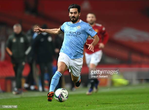 Ilkay Gundogan of Manchester City runs with the ball during the Carabao Cup Semi Final match between Manchester United and Manchester City at Old...