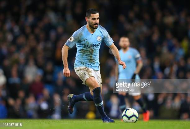 Ilkay Gundogan of Manchester City runs with the ball during the Premier League match between Manchester City and Watford FC at Etihad Stadium on...