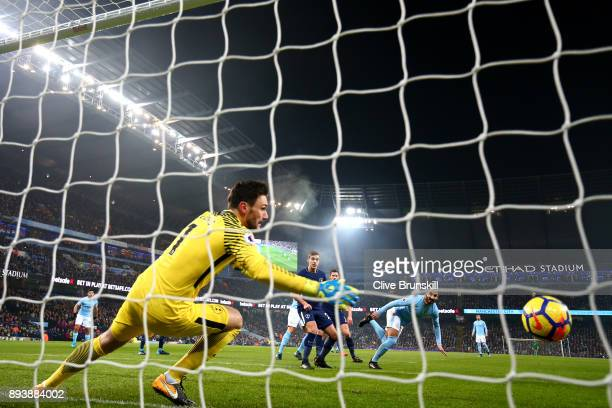 Ilkay Gundogan of Manchester City scores his sides first goal past Hugo Lloris of Tottenham Hotspur during the Premier League match between...