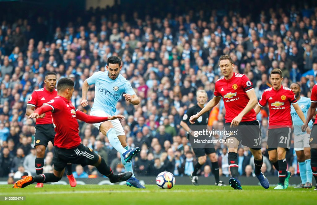https://media.gettyimages.com/photos/ilkay-gundogan-of-manchester-city-scores-his-sides-second-goal-during-picture-id943050474