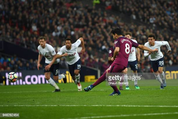 Ilkay Gundogan of Manchester City scores his sides second goal from the penalty spot during the Premier League match between Tottenham Hotspur and...