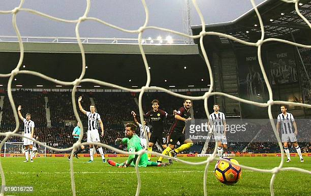 Ilkay Gundogan of Manchester City scores his sides third goal during the Premier League match between West Bromwich Albion and Manchester City at The...
