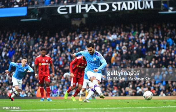 Ilkay Gundogan of Manchester City scores his teams first goal during the FA Cup Fourth Round match between Manchester City and Fulham at Etihad...