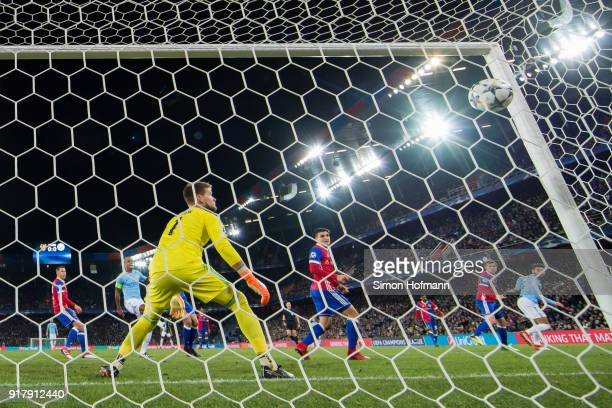 Ilkay Gundogan of Manchester City scores his team's first goal past goalkeeper Tomas Vaclik of Basel during the UEFA Champions League Round of 16...