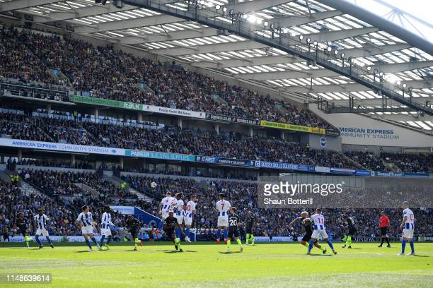 Ilkay Gundogan of Manchester City scores his team's fourth goal during the Premier League match between Brighton Hove Albion and Manchester City at...