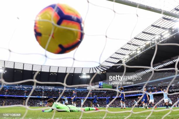Ilkay Gundogan of Manchester City scores his team's fourth goal past Kepa Arrizabalaga of Chelsea during the Premier League match between Manchester...