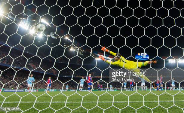 Ilkay Gundogan of Manchester City scores his team's fourth goal past goalkeeper Tomas Vaclik of Basel during the UEFA Champions League Round of 16...