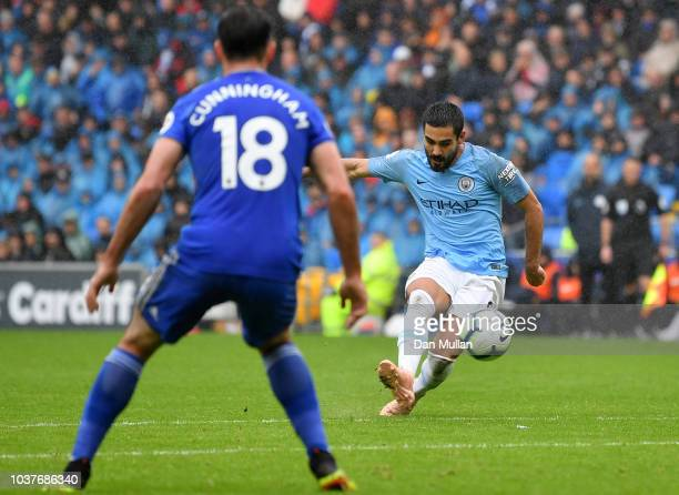 Ilkay Gundogan of Manchester City scores his team's third goal during the Premier League match between Cardiff City and Manchester City at Cardiff...