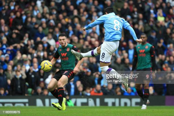 Ilkay Gundogan of Manchester City scores his team's third goal during the Premier League match between Manchester City and Aston Villa at Etihad...