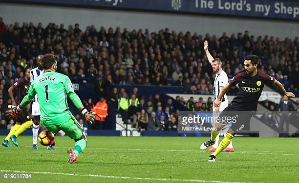 Ilkay Gundogan of Manchester City scores his team's third goal past Ben Foster of West Bromwich Albion during the Premier League match between West...