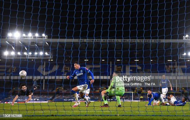 Ilkay Gundogan of Manchester City scores the opening goal with diving header past Ben Godfrey and Joao Virginia of Everton during the The Emirates FA...