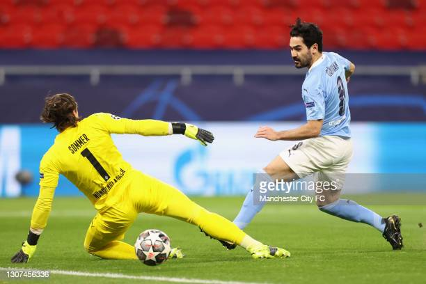Ilkay Gundogan of Manchester City scores their side's second goal past Yann Sommer of Borussia Moenchengladbach during the UEFA Champions League...