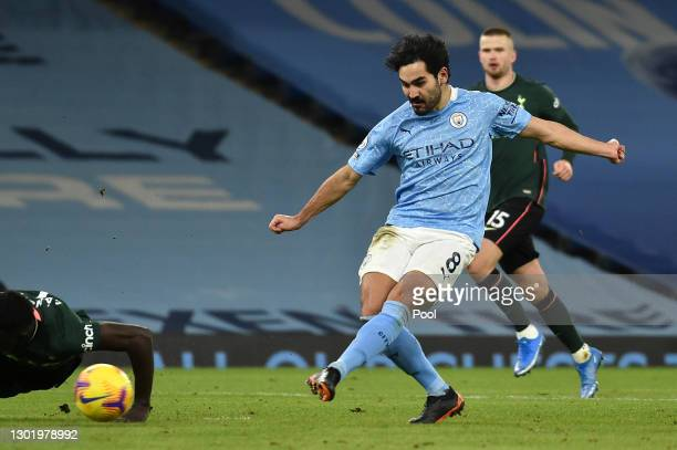 Ilkay Gundogan of Manchester City scores their side's third goal during the Premier League match between Manchester City and Tottenham Hotspur at...
