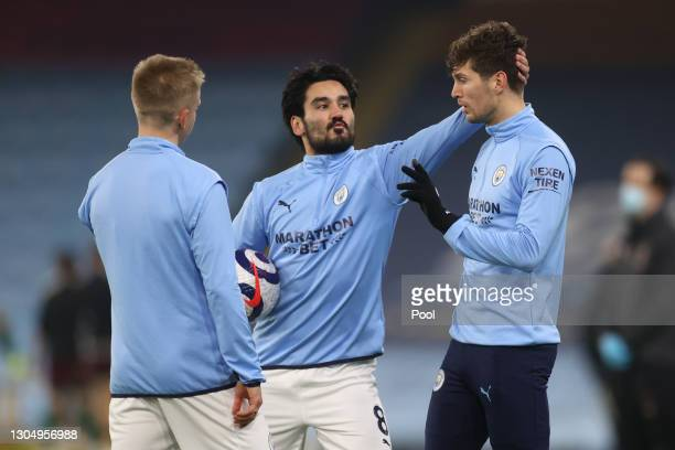Ilkay Gundogan of Manchester City shares a joke with John Stones during the warm up prior to the Premier League match between Manchester City and...