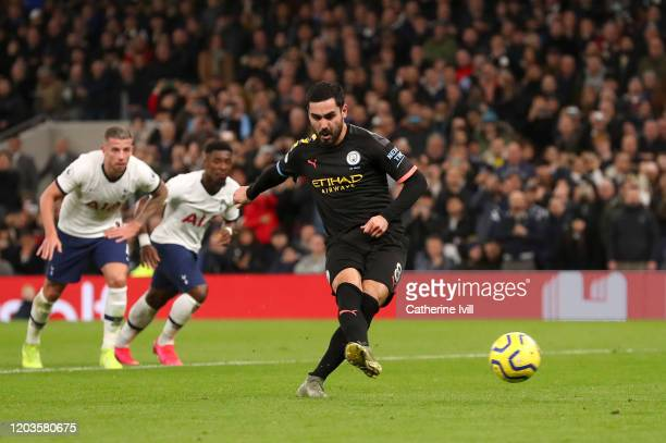 Ilkay Gundogan of Manchester City shoots from the penalty spot which is then saved by Hugo Lloris of Tottenham Hotspur during the Premier League...