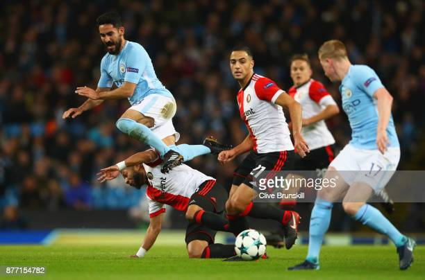 Ilkay Gundogan of Manchester City Sofyan Amrabat of Feyenoord and Kevin De Bruyne of Manchester City in action during the UEFA Champions League group...