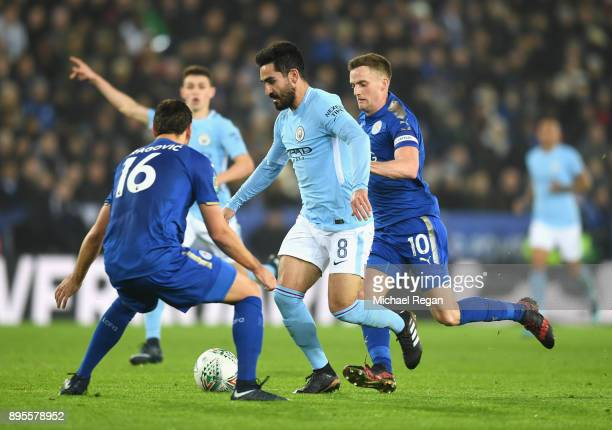 Ilkay Gundogan of Manchester City takes on Aleksander Dragovic and Andy King of Leicester City during the Carabao Cup QuarterFinal match between...