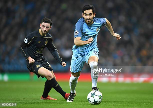 Ilkay Gundogan of Manchester City takes the ball past Patrick Roberts of Celtic during the UEFA Champions League Group C match between Manchester...