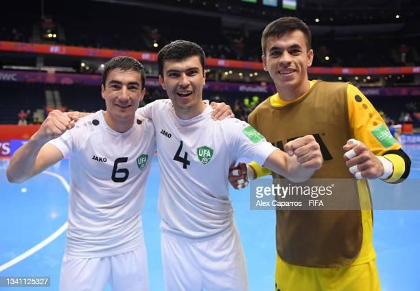 Ilkhomjon Khamroev of Uzbekistan, Ikhtiyor Ropiev of Uzbekistan and Abbos Elmurodov of Uzbekistan celebrate the win during the FIFA Futsal World Cup...