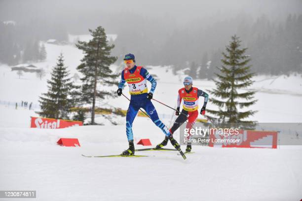 Ilkka Herola of Finland and Akito Watabe of Japan competes during the Men's Gundersen Normal Hill HS109/10.0 Km at the Viessmann FIS Nordic Combined...