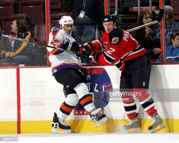 Ilkka Pikkarainen of the Albany River Rats and John Slaney of the Philadelphia Phantoms fight along the boards on October 9, 2005 at the Wachovia...