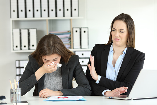 Ill businesswoman and a colleague rejecting her 957422572