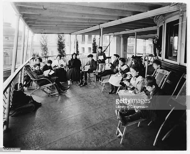 Ill children patients of Bellevue Hospital learn weaving and knitting on the Southfield boat in New York