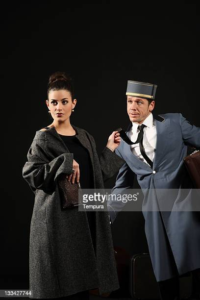 ill treatment elegant snob lady bulling the bellhop horizontal - tall person stock pictures, royalty-free photos & images
