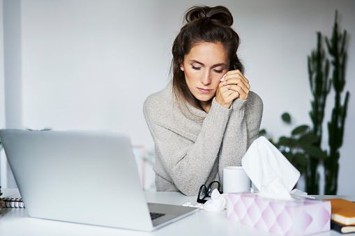 Ill woman working at home at desk - gettyimageskorea