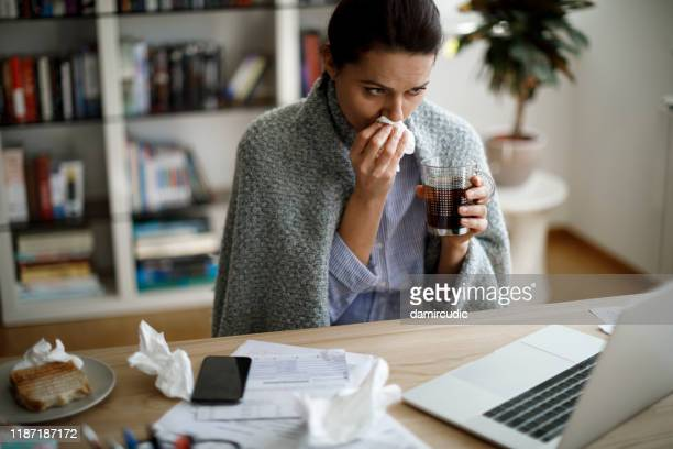 ill woman working from home office - season stock pictures, royalty-free photos & images