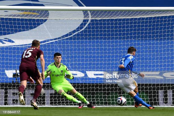 Illan Meslier of Leeds United fails to save a penalty kick from Pascal Gross of Brighton and Hove Albion as he goes on to scores his side's first...