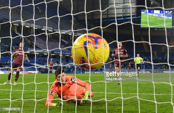 Illan Meslier of Leeds United looks on after Christian Pulisic of Chelsea scores their side's third goal during the Premier League match between...