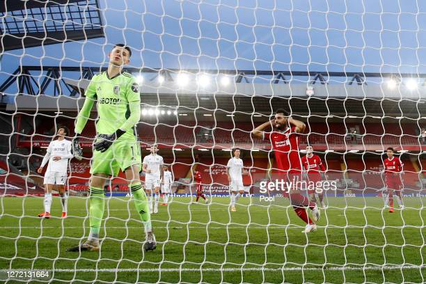 Illan Meslier of Leeds United reacts as Mohamed Salah of Liverpool celebrates after scoring his team's fourth goal during the Premier League match...