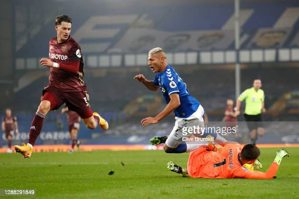 Illan Meslier of Leeds United saves from Richarlison of Everton, who goes to ground during the Premier League match between Everton and Leeds United...