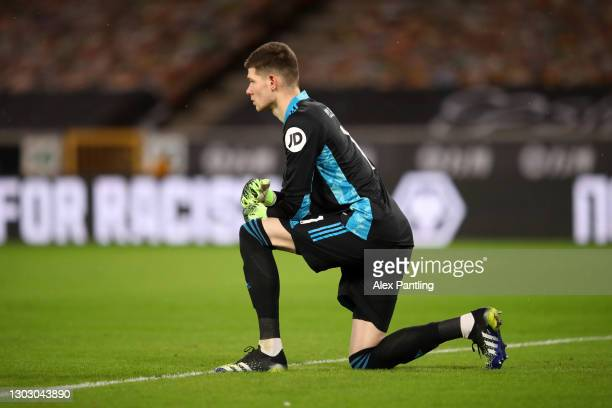 Illan Meslier of Leeds United takes a knee in support of the Black Lives Matter movement prior to the Premier League match between Wolverhampton...