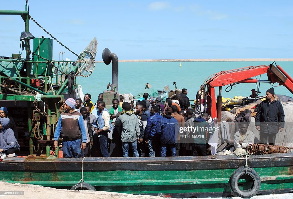 Illegal African migrants arrive at the port in the Tunisian town of Zarzis, some 50 kilometres west of the Libyan border, on March 19, 2015, after Tunisian fishermen rescued 82 African migrants off the coast of the town aboard a makeshift boat bound for the Italian island of Lampedusa. The group were fleeing the conflict in neighbouring Libya.